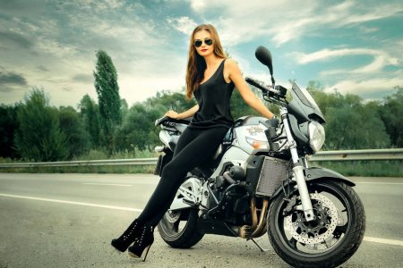 This image has an empty alt attribute; its file name is depositphotos_171820406-stock-photo-sexy-biker-girl-stands-on-1.jpg